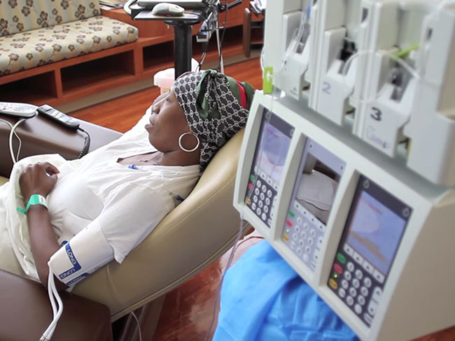 woman-with-headscarf-getting-chemo-treatment-wide